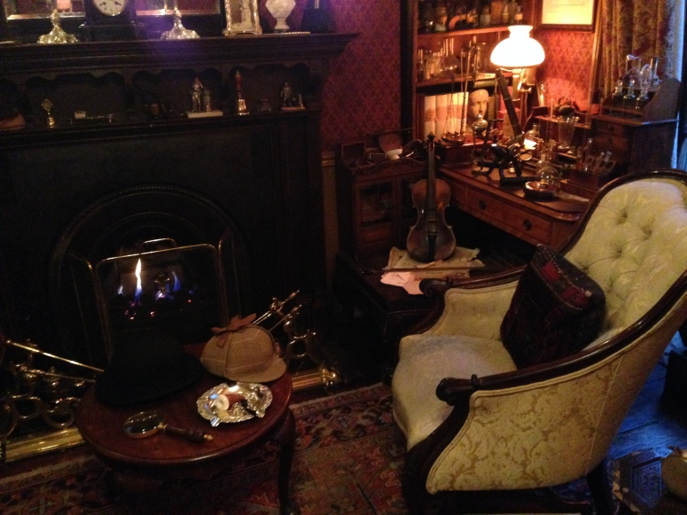 Sherlock's chair with his hat and magnifying glass